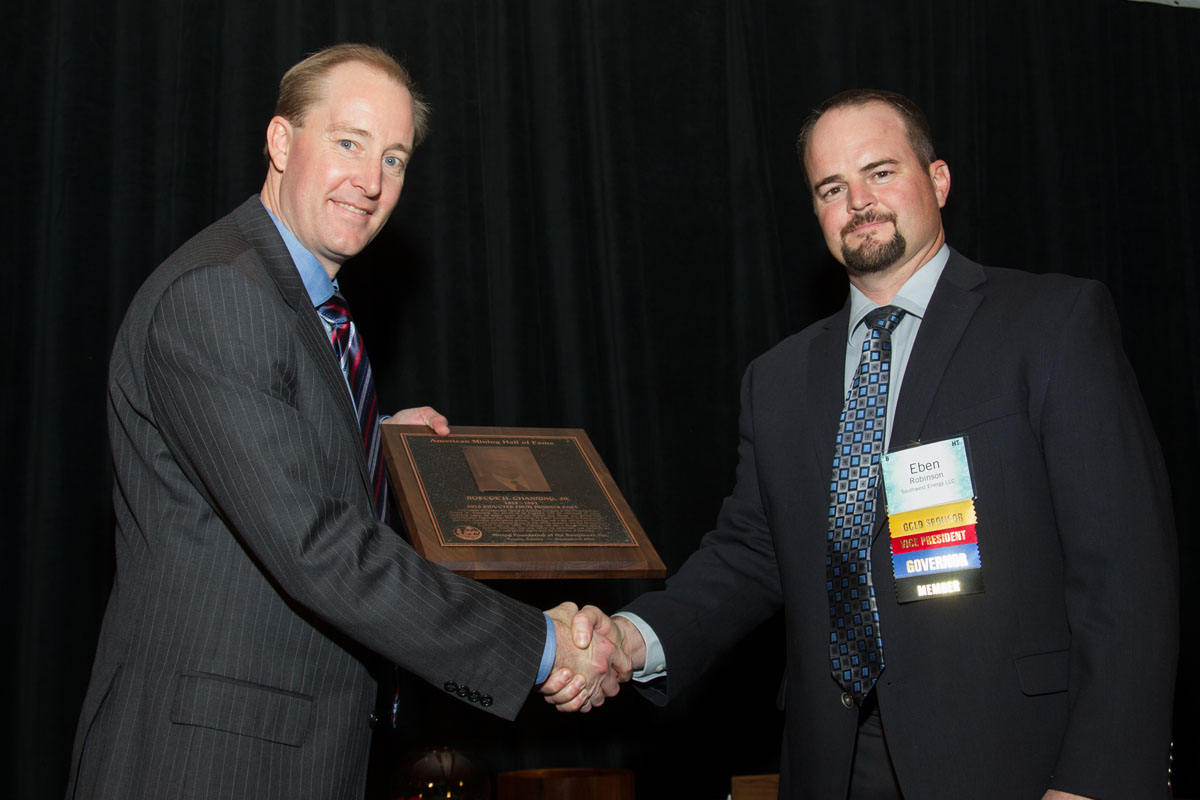 Patrick Merrin, VP, Hudbay Minerals, Arizona Business Unit accepts Mining's Past plaque for Roscoe Channing