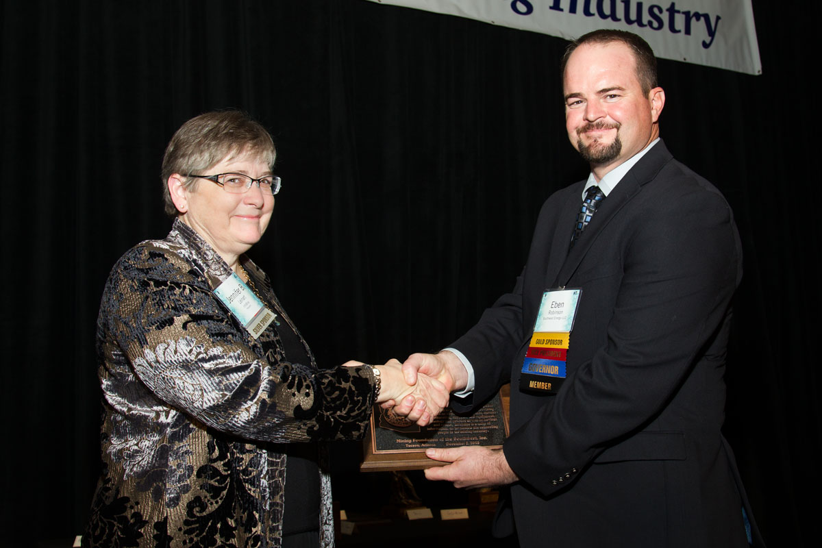 Jennifer Leinart, President of InfoMine recieves Industry Partnership Award from Eben Robinson